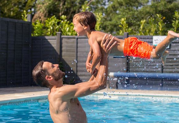 Father & son playing swimming pool Lakes Rookley