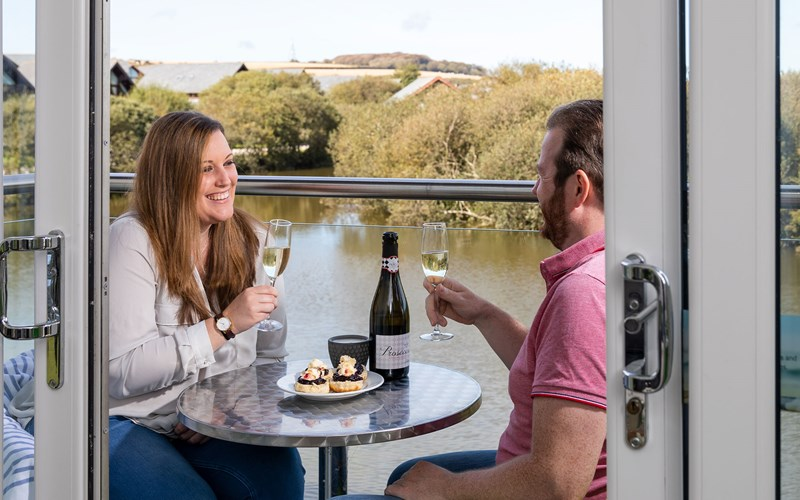 Couple on the Balcony with Prosecco