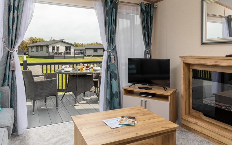 Lodge lounge and decking Bude Resort